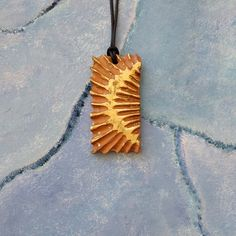 This hand carved wooden pendant is a perfect accessory for any occasion and a great gift for art lovers. Gifts For Art Lovers, Lovers Art, Arrow Necklace, Pendant Necklace, Electrical Tools, Wood Art, Hand Carved, Great Gifts, Sculptures