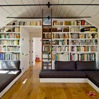 Fantastic way to build a bookcase around a door.