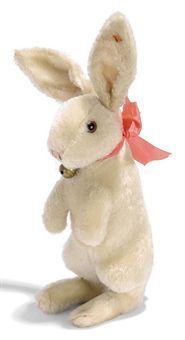 A STEIFF LARGE BEGGING RABBIT, (4344,2), white mohair, brown and black glass eyes, pink and black stitching, whiskers, swivel head, inoperative squeaker, ribbon with bell and FF button with red cloth tag, circa 1930 --15in. (38cm.) high (red cloth tag faded)