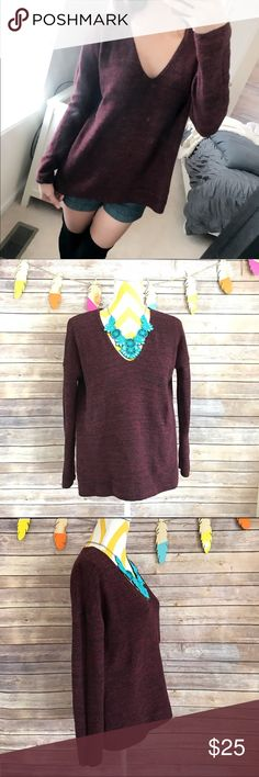 Burgundy red oversize v neck sweater Burgundy wine color, knitted. Boxy style and has v neck collar. Back is slightly longer than the front. Oversize style. Only worn to model, washed but never worn. Cozy and warm. No flaws. Would fit a medium too. 70% cotton 25% polyester 5% other fibres H&M Sweaters V-Necks