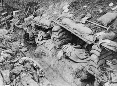 WW1: British soldiers resting in sleeping shelters in a trench. Contalmaison. Battle of the Somme,September 1916