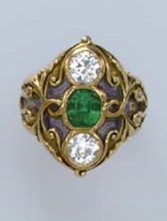 AN ART NOUVEAU EMERALD AND DIAMOND RING, BY MARCUS & CO. Centering on rectangular-cut emerald, vertically flanked by old European-cut diamonds, to the chased gold scrolling surround and shoulders, enhanced by translucent violet enamel, mounted in gold, circa 1895. Signed M & Co. for Marcus & Co
