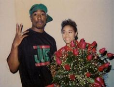 Fashion icons in the i love that photo of tupac with those thug life overalls which was definitely a staple trend during that era for both sexes. 2pac, Tupac Shakur, Jada Pinkett Smith, Jada Pinkett Tupac, Tupac And Jada, Afro, Tupac Wallpaper, Tupac Makaveli, Tupac Pictures