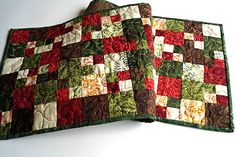 Batik Quilted Table Runner in Red, Green, Orange and Brown Patchwork by MyBitOfWonder on Etsy https://www.etsy.com/listing/508594335/batik-quilted-table-runner-in-red-green