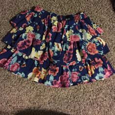 A small size skirt A cute skirt from rue 21, size small. Floral print, worn a few times but looks brand new. No strings or stains, great condition. Willing to do trade. Bottom Hits around mid thigh. Loops for a belt, but I lost the belt. Rue 21 Skirts