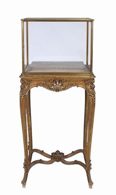 A French brass and giltwood vitrine , 19th century