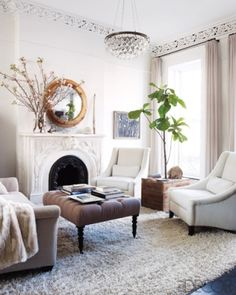 Living Room | all-white | Kerri Russell / i like the ottomon idea in the middle