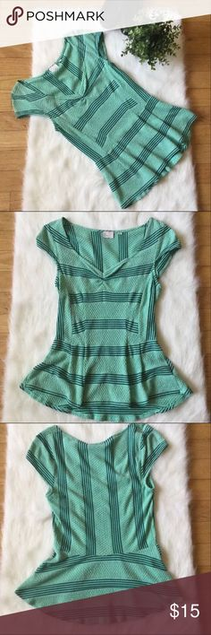 Postmark Sweetheart Peplum Texrured Top Size M Anthropology Postmark Sweetheart Peplum Top Size M striped, color Blue/Green. Top has cap sleeves, textured detail, peplum bottom. Material: 71% rayon, 24% polyester, 5% spandex. Measurements approx: pit to pit 23 inches, shoulder to hem 28 inches (flat lay) Please feel free to ask questions or request pictures. Anthropologie Tops