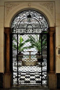 Cadiz, Andalucia, Spain Love the gated door to an inner courtyard. Indoor Courtyard, Courtyard Entry, Spanish Revival, Spanish Style, Spanish House, Spanish Colonial, Andalusia Spain, Seville Spain, Wrought Iron Gates