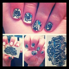diy temporary tattoo nail decal:  Base coat, two coats of white, cut out the parts you want on your nail from a temporary tattoo. Line up the base with the cuticles, press a wet paper towel for about 15 seconds, top coat.