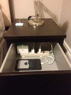 Install a surge protector in a drawer so you can charge your phone and tablet out of sight! LOVE this idea