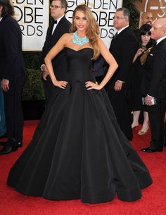 Sofia Vergara wears a black mermaid gown by Zac Posen, Lorraine Schwartz turquoise jewels and Brian Atwood heels to the #GoldenGlobes.