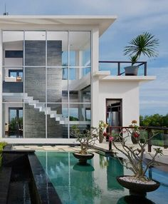 Amazing glass walls in this hilltop house with endless views.  Villa Moonlight, Bali, Indonesia.