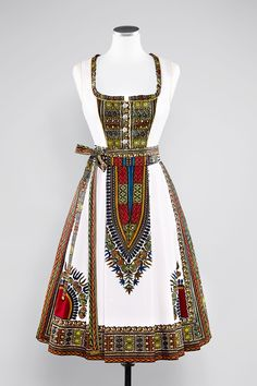 Noh Nee Dirndl Noura has a classic Bavarian Dirndl cut and an extravagant African pattern. #nohnee