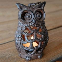 Owl Lantern - ideas forming on how to make this. For large size, could make front with horseshoes, eyes with hubcaps, maybe?