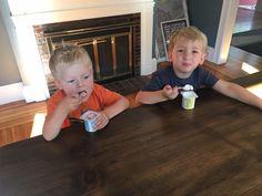 My Grandson and buddy having yogurt on a Lorimer table