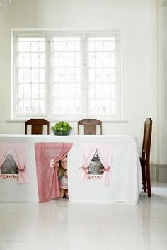 Image of a dining room transformed into a playroom with a dining room table hideout