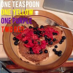 Lean and clean pancakes! For the batter I blended one yellow of oats, two eggs (one red), one red of Greek yogurt, teaspoon of baking powder and two teaspoons of cinnamon. I topped with one teaspoon of peanut butter and one purple of raspberries and blueberries.