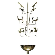Rare 1940s Brass Chandelier by Tommi Parzinger for Parzinger Originals | From a unique collection of antique and modern chandeliers and pendants  at https://www.1stdibs.com/furniture/lighting/chandeliers-pendant-lights/