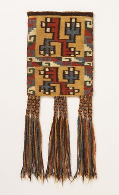 Bag for Coca Leaves | Peru; South Coast; Nasca culture; Wari-related | 600-800 | Camelid fiber and cotton; dovetailed tapestry with loop stitch embroidery and braided fringe | Los Angeles County Museum of Art | Object #: M.74.151.16