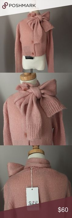 Kids PATRIZIA PEPE pink bow sweater A beautiful pink fall/winter sweater by Italian designer PATRIZIA PEPE. This is from her children's boutique line. A long sleeve pink wool blend sweater/cardigan with buttons down the front. A stunning neckline that features a DETATCHABLE scarf that ties into a bow. Wear over a dress, with a skirt, pants, jeans etc... And dress up any outfit. Absolutely gorgeous!!! BNWT. Size L 12🚫trades Shirts & Tops Sweaters