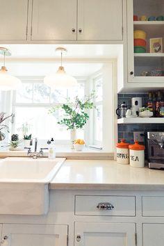 Sneak peek: Chelsea & Forrest Kline via Design Sponge. Love the little balcony in front of sink