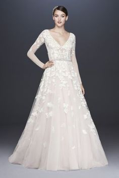 This captivating long sleeve wedding dress catches the light in so many gorgeous ways, from the crystal-beaded waistband to the jeweled buttons down the illusion back, to the sparkling sequin lace appliques on the skirt. Adding to the drama are a plunging illusion bodice with visible corsetry and a pink-tinted underskirt that gives your wedding look a coy hint of color.  Galina Signature, exclusively at David's Bridal  Polyester  No train  Back zipper; fully lined  Dry clean  Imported  Also