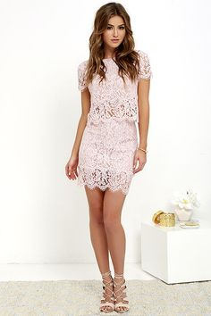 You'll fondly reminisce on all the good times you've had (and will have!) in the Turn Back Time Blush Pink Lace Two-Piece Dress! Blush pink eyelash lace overlay shapes a cute crop top with a round neckline and short sleeves. A second layer of lace drops below the scalloped hem to create a sheer, tiered look. Matching skirt finishes off the set with its figure-accentuating fit and tiered mini-length hem. Top has keyhole and button closure at back. Skirt has hidden back zipper/clasp. Small…