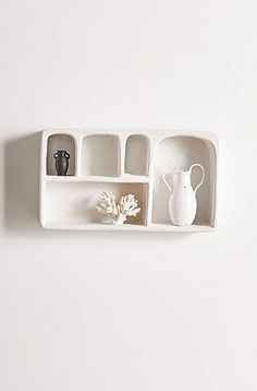 Bring a naturalistic bohemian feel to your space with this UOexclusive concrete wall shelf. Featuring five cubbies in a variety of sizes to show off your favorite trinkets and treasures. Mounts to wall aluminum hook included. Content  Care    Concrete    Wipe clean    Imported   Size    Dimensions 28l x 6w x 15.6h    Shelving weight limit 26.46 lbs    Weight 39.68 lbs    Shipping package dimensions 30l x 8w x 18h    Shipping package weight 46.3 lbs Home Decor Accessories, Decorative Accessories, Accessories Online, Office Accessories, Decorative Accents, Urban Outfitters Home, Concrete Wall, Spring Home, Cubbies