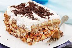 Aπολαυστική τούρτα µε µπισκότα βουτηγµένα σε καφέ και αµαρέτο.