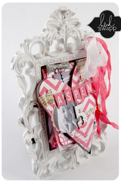 Mini book in a picture frame by Heidi Swapp