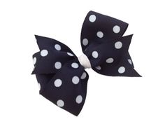 Navy blue polka dot hair bow by BrownEyedBowtique on Etsy, $5.00