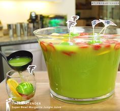 Superbowl Margarita Jungle Juice - For more delicious recipes and drinks, visit us here: www.tipsybartender.com