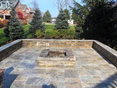 firepit with seatwalls on a travertine patio