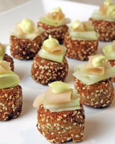 Mini Asian Crab Cakes -- Mini crab cakes encrusted with sesame seeds get a kick from wasabi and soy sauce. The toppings of wasabi, mayonnaise, cucumber, and pickled ginger add creaminess, crispness, and tang, as well as colour.