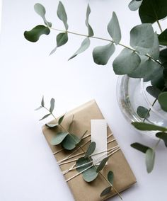 Beautiful + minimal DIY Christmas wrapping idea - kraft paper, string and eucalyptus.