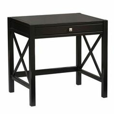 """Writing desk with a pull-out keyboard tray and openwork X-shaped side panels.         Product: Desk   Construction Material: Pine and painted MDF  Color: Antique black  Features: Tray for keyboardUse as a writing desk or laptop desk  Dimensions: 30"""" H x 31.5"""" W x 24"""" D"""