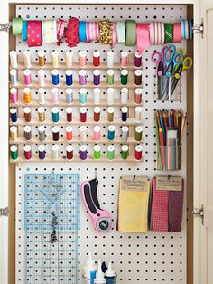 Hang Time Pegboard isn't just for workbenches. A sheet was cut to fit inside a cabinet and painted with durable oil-base paint. Hooks hold tools and fabric swatches. Clear plastic cups house scissors and colored pencils. A tension rod holds ribbon in place.