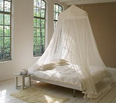 This King Size Mosquito Net has a canopy top, a circumference of – and a height of – It is suspended from a single point above the bed and is suitable for queen- an