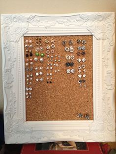 Cork board stud earring holder. I wear more studs than anything else and I had a hard time organizing them. The cork holds the studs in place when upright and you can re-stick the cork many times without the studs falling out! Made for less than $10 too!! #StudEarrings
