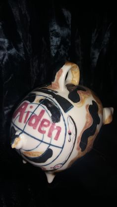 Aidens camo piggy bank from the back, he is into hunting and fishing.