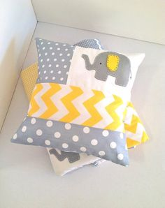 yellow, grey, & white elephant baby quilt & pillow via etsy.com, really want this for new baby!