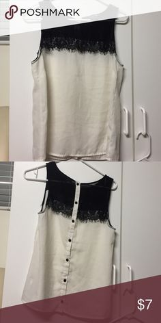Sleeveless top Has some lace detailing. With black buttons in the back. Gently worn. Tops