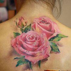 Beautiful back pink roses tattoo realistic