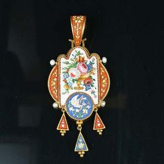 A mid 19th century micro-mosaic pendant and earring suite, circa 1860, the pendant with a shield-shaped plaque to the centre, decorated with a polychrome mosaic depicting a spray of roses in full bloom with trailing foliate detail, the circular panel beneath depicting a dove holding a myrtle branch in its beak within lobed scroll borders, suspending three triangular-shaped drops below, the pair of pendent earrings of similar design, length of pendant 8.1cm., length of earrings 6.9cm.