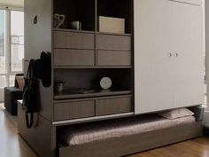 Smart robotic multifunctional unit for micro-apartments transforms with touch of a button (Video)