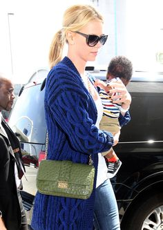 CHARLIZE THERON DIOR OSTRICH MISS DIOR BAG  A crossbody is a smart way to go for moms of small children, and if it's an exotic Dior crossbody, well, all the better.