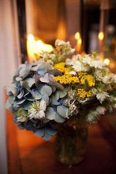 white, yellow, green and blue flower centerpiece | vintage Bohemian chic wedding | photo: Mantas Wright Photography | design: Matthew Robbins Design