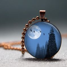 This pendant would look gorgeous hanging low if you were wearing a black shirt.  From etsy seller artyscapes