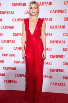 Kate Hudson in a jazzy Naeem Khan jumpsuit with sequins meant for kicking ass, taking names, and potentially breaking it down on the holiday-party dance floor | November 20, 2015